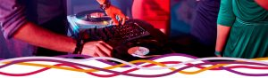 DJ playing records at a John Godber Centre disco