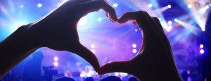 hands making a heart shape at a John Godber Centre concert