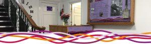 Reception desk and Canon Godber interpretation panel at the John Godber Centre, Hucknall