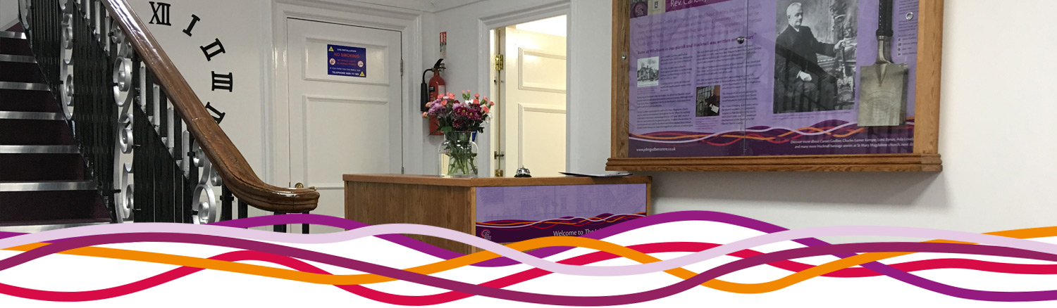 Reception desk and Canon Godber interpretation panel at the John Godber Centre, Hucknall