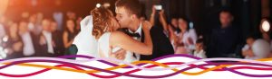 Bride and groom kissing during wedding dance at the John Godber Centre