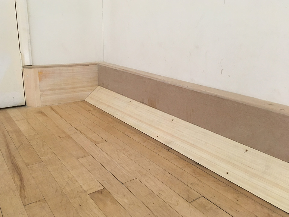 Close up of the new skirting in the Main Hall at the John Godber Centre
