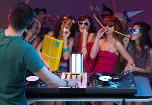 DJ and guests dancing at a party at the John Godber Centre, Hucknall
