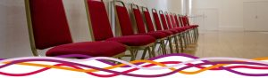 Close up of red chairs in the Main Hall at the John Godber Centre, Hucknall, Notts
