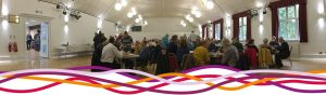 A large celebration in the Portland room (main hall), at the John Godber Centre