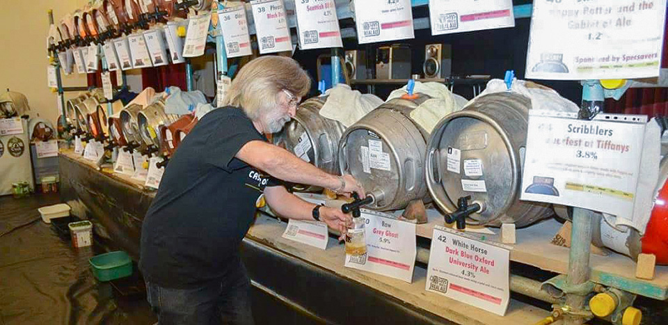 Setting up the kegs for the Hucknall Beer Festival at the John Godber Centre, Hucknall