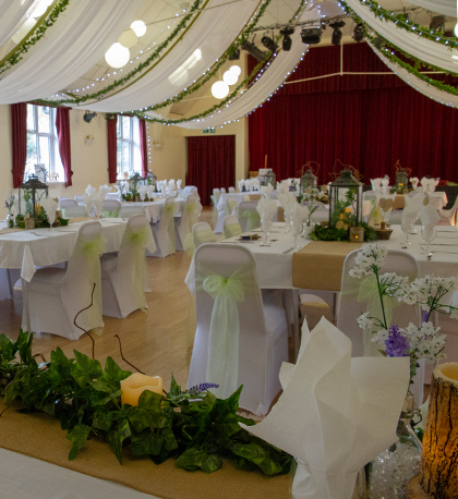 Main Hall room prepared for a woodland-themed wedding reception