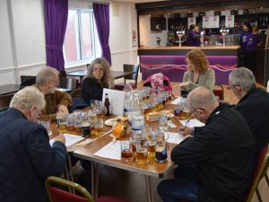 The judges' final deliberation in the Champion Beer of Nottinghamshire competition 2019