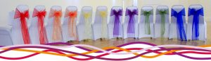 Selection of chairs dressed for a Wedding reception at the John Godber Centre, Hucknall